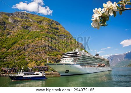 Flam Village With Ship In Harbor Against Fjord During Spring Time, Norway