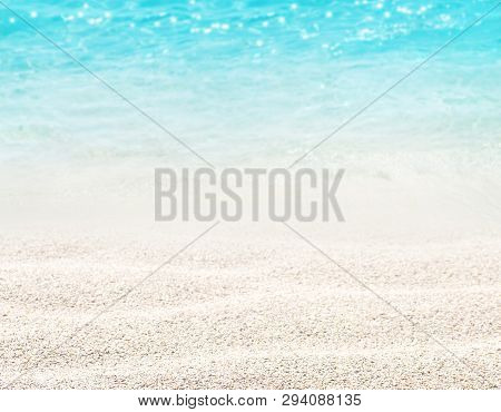 Beach Blurred Background. Sandy Shore Washing By The Wave. Dreams Summer Vacations Destination. Crys