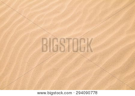 Beautiful Nature Sandy Summer Background. Abstract Pattern Of Wave Sand On Beach Formed By Wind. San