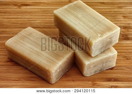 Three Eco Soap Bars On A Wooden Background.
