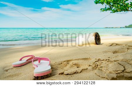 Pink And White Sandals On Sand Beach. Casual Style Flip-flop Were Removed At Seaside. Summer Vacatio