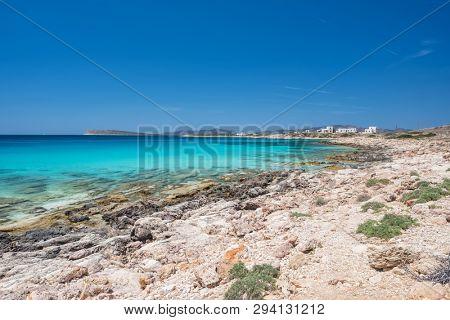 Rocky beach with amazing tranquil water on Paros island, Cyclades, Greece.