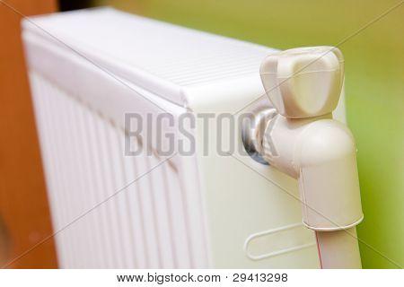 White Radiator With Radiator Thermostat.
