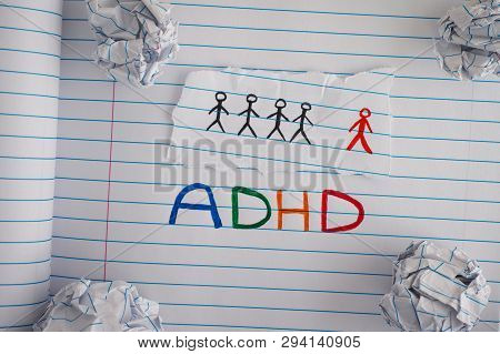 Adhd. Abbreviation Adhd On Notebook Sheet With Some Crumpled Paper Balls On It. Close Up. Adhd Is At