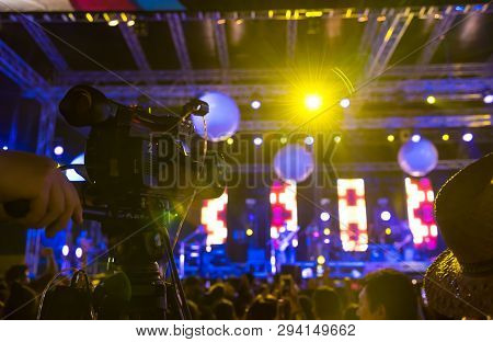 Cameraman Silhouette On A Concert Stag Hall. Camera Shooting Video Production Production Camera Phot