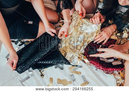 Girls Relaxation Time. Glamor Look And Lifestyle Trends. Women In Black Choosing Sequin Outfit. Urba