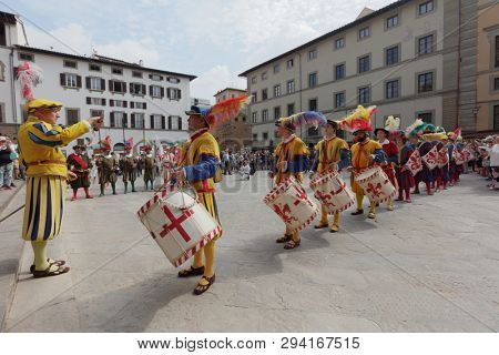 FLORENCE, ITALY - AUGUST 10, 2018: Historical parade during Feast of San Lorenzo. This annual event deeply rooted in the city's tradition, and ending by giving lasagna and watermelon to everyone