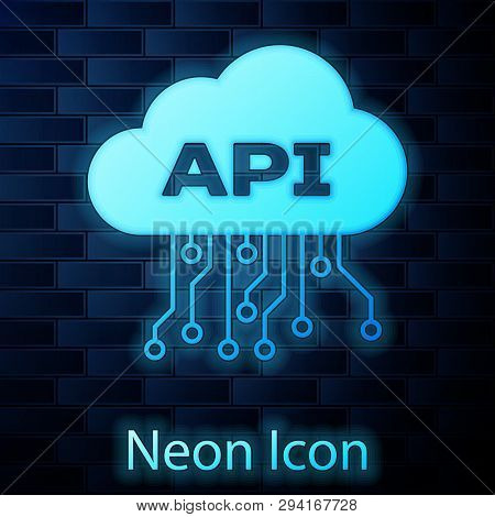 Glowing Neon Cloud Api Interface Icon Isolated On Brick Wall Background. Application Programming Int