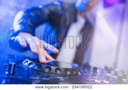 Dj Mixing At Party Festival With Blue Light And Smoke In Background - Summer Nightlife View Of Disco