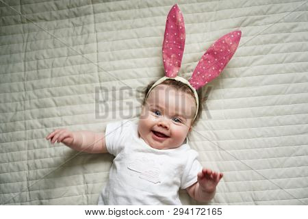 Like Bunny Rabbits. Cute Children In Easter Bunny Style. Small Children In Easter Bunny Headbands. L