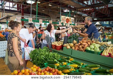 Montreal, Quebec, Canada September 29, 2018: Woman Buying Produce By Fruit And Vegetable Stands At J