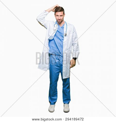 Handsome doctor man wearing medical uniform over isolated background confuse and wonder about question. Uncertain with doubt, thinking with hand on head. Pensive concept.