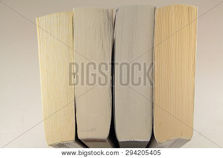 View On The Top Of Four Paperbacks On A Table