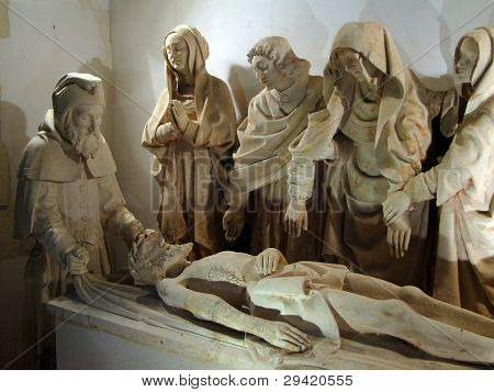 Sculpture of Christ's Entombment late 15rh century St. Peter's church Carennac France poster