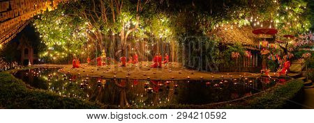 CHIANG MAI THAILAND- FEBRUARY 19, 2019 : Makha bucha day celebrations in Chiangmai.Traditional monks pray under illuminated Buddha statue annually at Wat Phan Tao temple in Chiangmai,Thailand