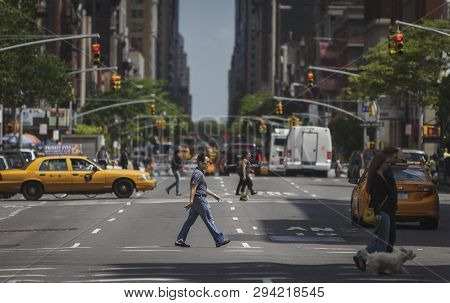 New York - May 18, 2016: People Crossing A Street In Downtown Manhattan. Tourists And Newyorkers Wal