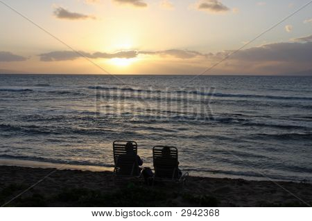 Couple Enjoing The Sunset