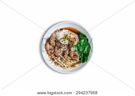 Bowl Of Asian Noodles With Vegetables And Pork On White Background