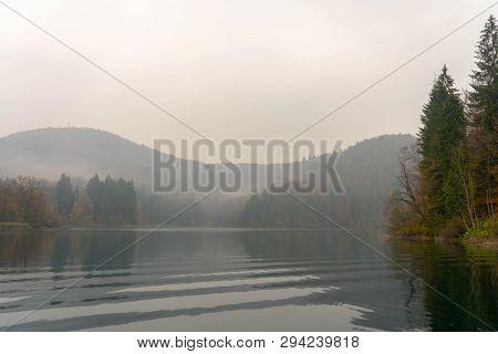 Croatia lake on a foggy fall morning poster