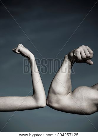 Rivalry, Vs, Challenge, Strength Comparison. Muscular Arm Vs Weak Hand. Vs, Fight Hard.competition,