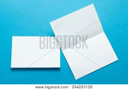 A Layout For Menus Or Brochures On A Blue Background. Two Sheet Brochures Or Greeting Cards. Mock-up