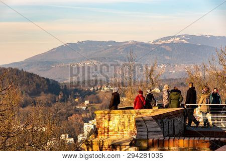 Graz,styria, Austria - 20.01.2019: View At City Surroundings And Mountains With People In Foreground