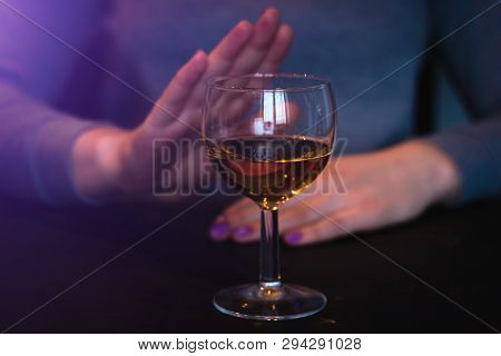 Young Woman Refuses Alcohol On Dark Background