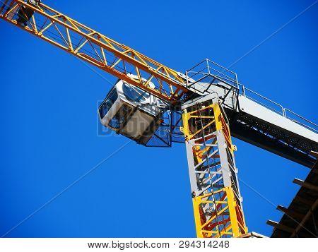 Crane. Self-erection Crane. Tower Crane Against Blue Sky. Construction Site.