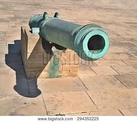 poster of Old artillery gun. The gun for the cores, covered with patina. Located at the royal palace in Morocco