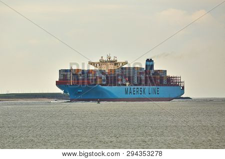ROTTERDAM, THE NETHERLANDS - CIRCA 2015: Maersk container ship arriving at the port Port of Rotterdam
