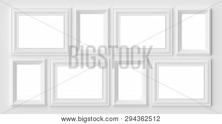 White Blank Photo Or Picture Frames On The White Wall With Shadows With Copy-space, White Colorless