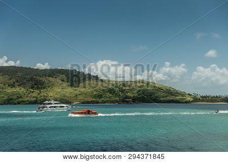 Hamilton Island, Australia - February 16, 2019: Jetski And Two Boats Just Outside The Marina. Green
