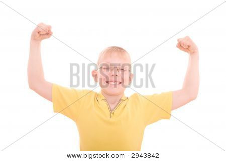 A Young Boy Flexes His Muscles