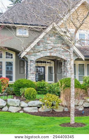 A perfect neighborhood. Houses in suburb at Spring in the north America. Fragment of a luxury house with entrance door and nice window.