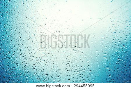 Water Drops On Blue Background / Drops Of Rain On Glass , Rain Drops On Clear Window / Blue Abstract
