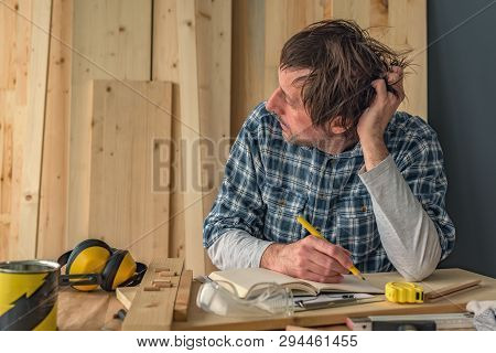 Carpenter Thinking In Small Business Woodwork Workshop Interior, Thoughtful Pensive Male Is Contempl