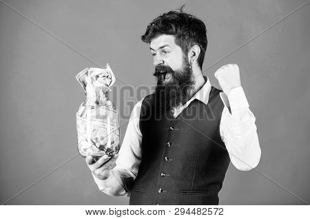 Businessman with his dollar savings. Richness and wellbeing. Security and cash money savings. Banking concept. General savings tips. Man bearded hipster hold jar full of cash. Financial success poster