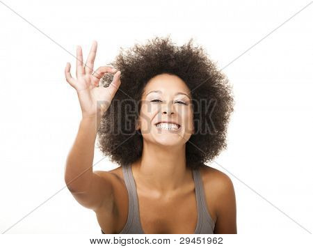 Happy Afro-American young woman isolated on white doing a okay signal with her hand
