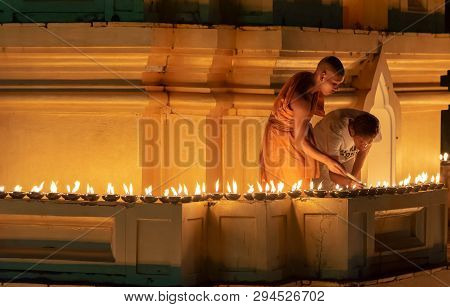 Songkhla, Thailand, Feb. 19, 2019 : Unidentified Buddhist Monks Lighting Candles Around The Church B