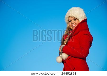 Portrait Of Woman In Red Coat Blue Backgound