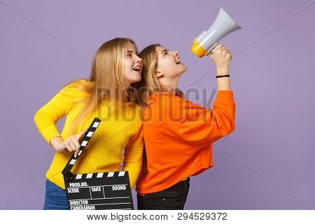 Two Cheerful Young Blonde Twins Sisters Girls Hold Classic Black Film Making Clapperboard, Scream On