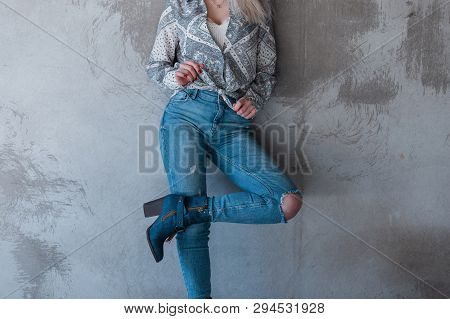 Young Blond Woman In An Elegant Summer Shirt With A Vintage Pattern In A White Trendy T-shirt In Blu