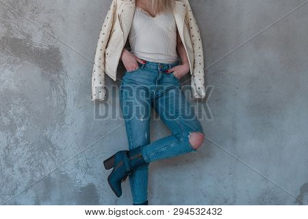 European Young Woman In Vintage Leather Jacket In Fashionable Ripped Jeans In Blue Trendy Cowboy Boo