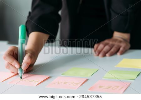 Business Strategy Design. Corporate Brainstorming And Brainwork. Woman Using Sticky Labels To Take N