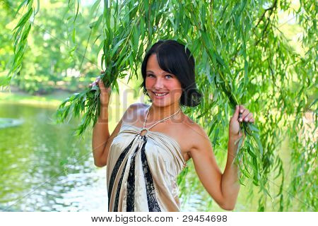 Young Smiling Model In Weeping Willow