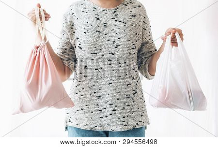 Ban Single Use Plastic. Zero Waste Shopping Concept. Woman Holding In One Hand Groceries In Reusable