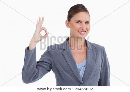Smiling tradeswoman giving approval against a white background poster