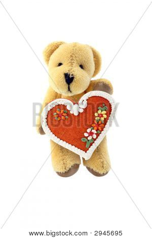 Teddy-Bear With Gingerbread Heart Isolated On White