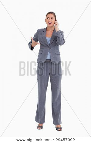 Angry tradeswoman yelling at caller against a white background