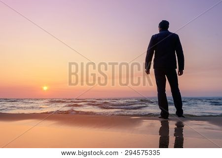 Silhouette Of A Man At Dawn / Beach Wilderness Dawn